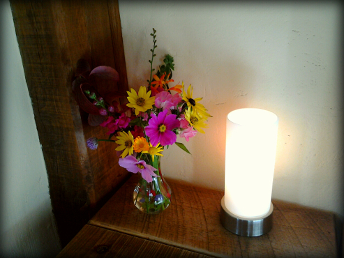 bedroom detail - lamp and vase of fresh flowers