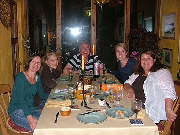 Guests with Shoron, enjoying a meal together at the cottage